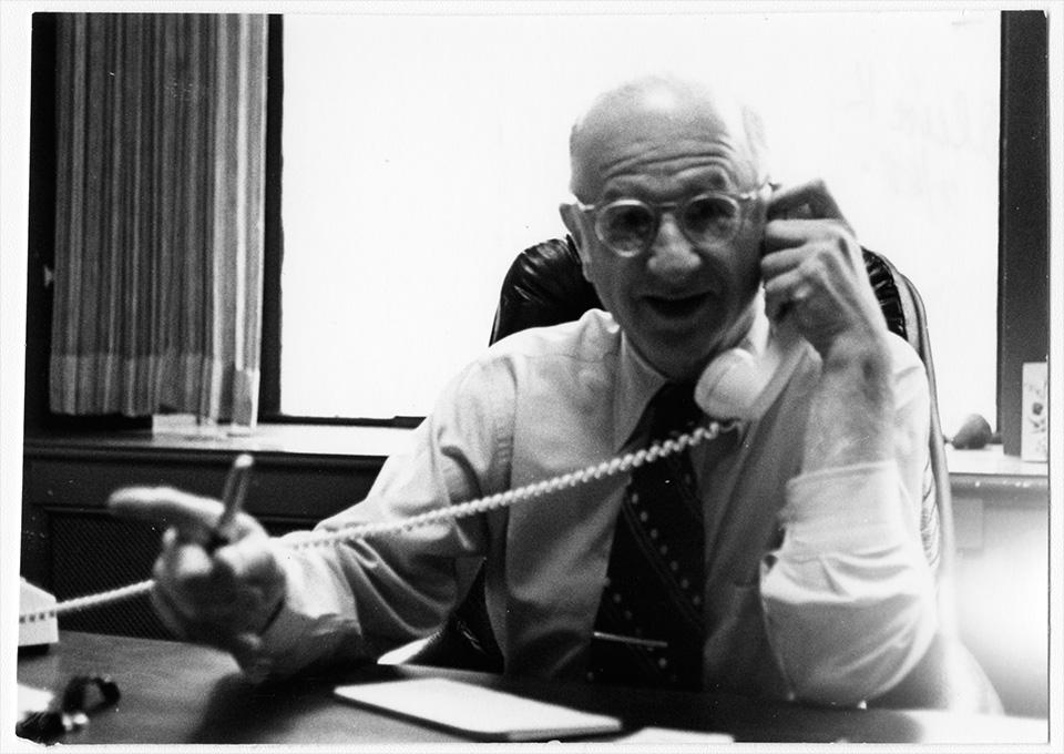 R.S. Mendelsohn on the telephone.