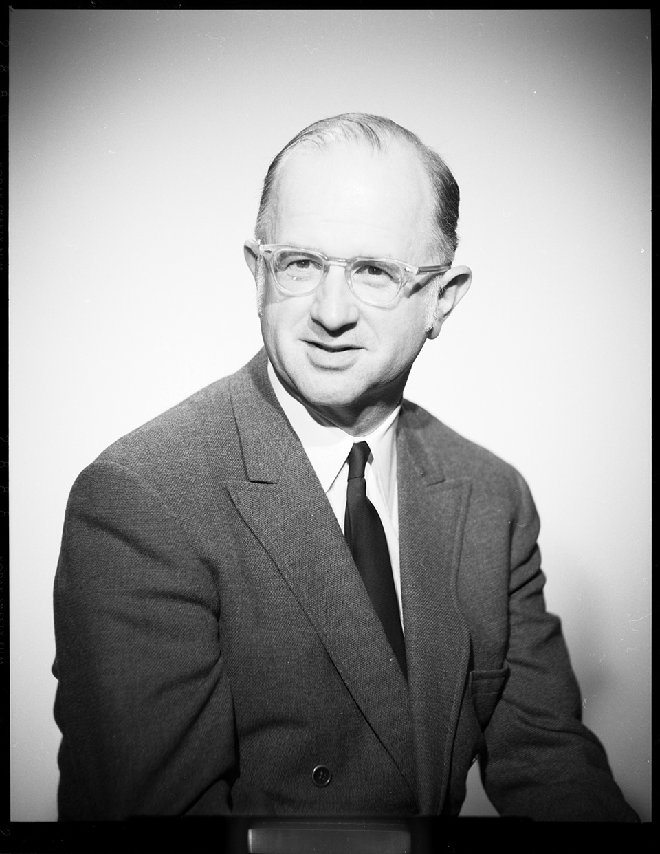 Close-up/headshot of R.S. Mendelsohn in a suit and looking into the distance and slightly to the right of the camera