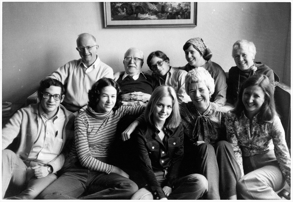 R.S. Mendelsohn , TG Remer, Harry Remer, Ruth Lockshin, and Annetta Remer sitting on a couch in front of Martin Lockshin, Sally Mendelsohn, Abby Remer, Rita Mendelsohn, and Pat Remer, in NYC on Thanksgiving 1977. Photographed by Michael Remer.