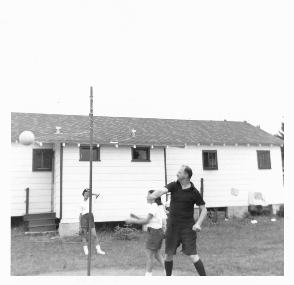 R.S. Mendelsohn hits the ball, as he and 2 [possibly 3?] girls play tetherball at Camp Marimeta in Eagle River, Wisconsin (where R.S. Mendelsohn was doctor from 1956-1967).